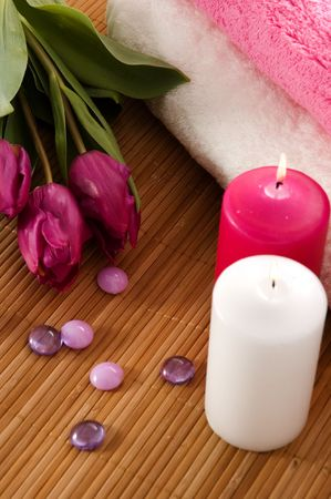 Towels, tulips and candles in a SPA composition. Banco de Imagens