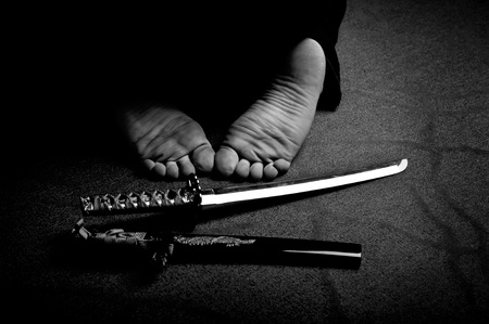 Man`s feet and ritual sword in black and white Stock Photo - 12066785
