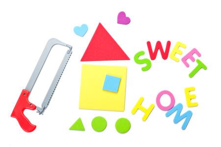 handsaw: Serrucho con casa y signo hogar dulce