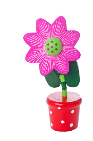 Floppy Wooden Flower Pushup Toy in a bright pot isolated on white