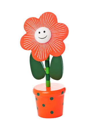 Floppy Wooden Flower Toy in a bright pot isolated on white Stock Photo