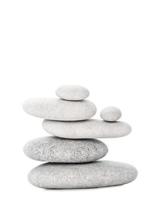 balanced rocks: Pile of sea stones on white background Stock Photo