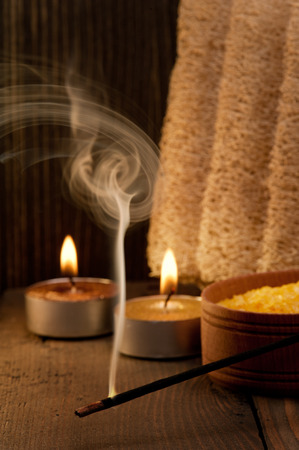 bod: Spa setting and fuming aroma stick on dark wooden background