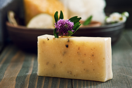 Handmade soap closeup with spa products on background