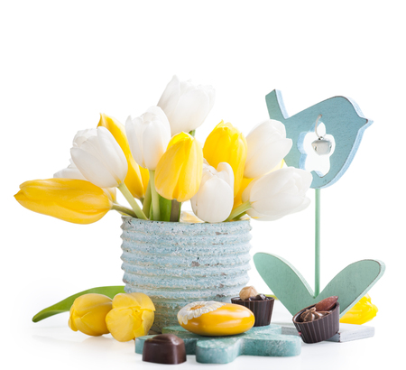 yellow heart: Easter decoration with yellow heart, chocolates and tulip flowers Stock Photo