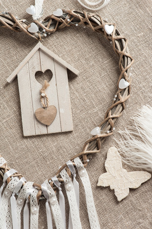 White lace heart shaped dream catcher with pearls. Wedding decor background Banco de Imagens