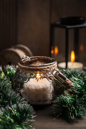 Still life with candles in lanterns and Christmas decoration, Xmas Holiday concept Stock Photo