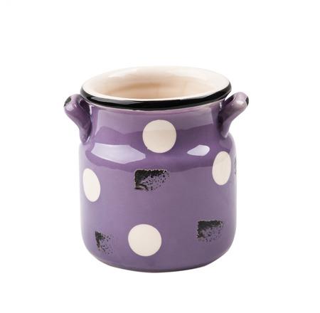 Purple rustic old enamel mug isolated on white background