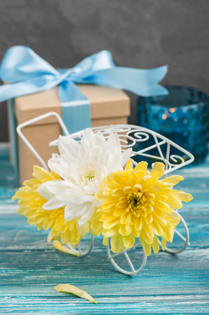 white and yellow chrysanthemum in a pot gift lit candle on stock