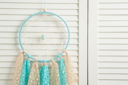 crocheted: Blue beige dream catcher with crocheted doilies in the interior