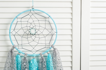 crocheted: Blue grey dream catcher with crocheted doilies in the interior