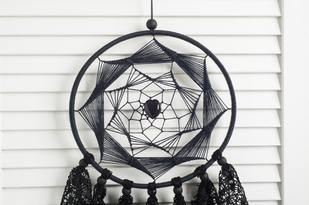 crocheted: Black dream catcher with crocheted doilies in the interior Stock Photo