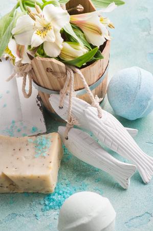 Bath bombs on blue concrete background, organic soap and salt