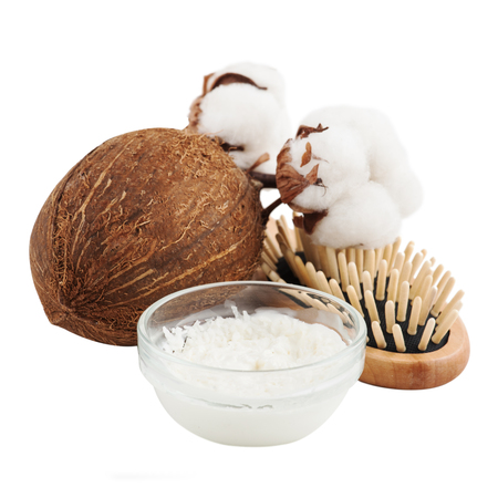Natural hair treatment with coconut butter and cotton flower. Spa set with brush isolated on white
