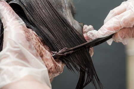Dying blond hair to black with brush