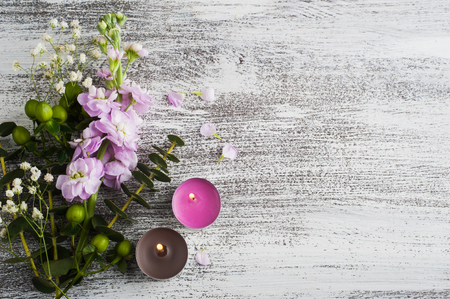 Flowers on rustic wooden background. Still life with copy space for text