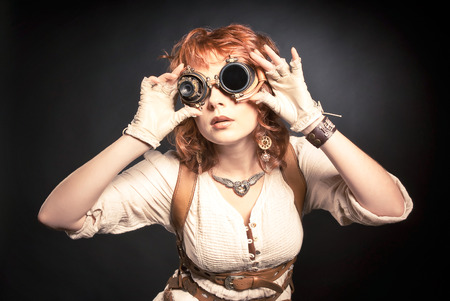 steampunk goggles: Beautiful redhair steampunk woman looking over her goggles