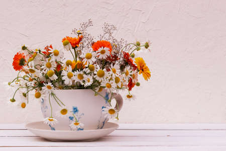 a bouquet of garden flowers in a vase. flower composition Imagens