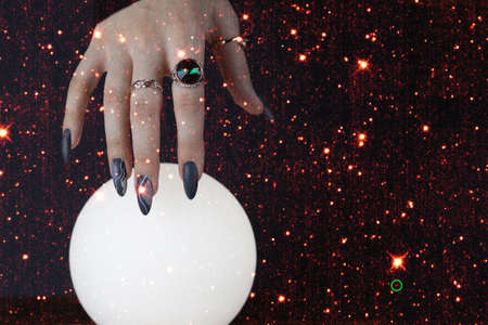 Psychic readings and the concept of clairvoyance. Fortune telling on a crystal ball.