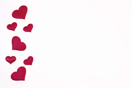 Valentine's day background. Red hearts on a white background. Valentine's day concept. Flat lounger, top view, copy space.