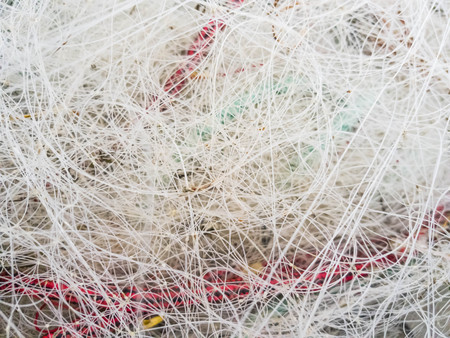 Used fishing line for sea fishing is stacked in pile. Stock Photo