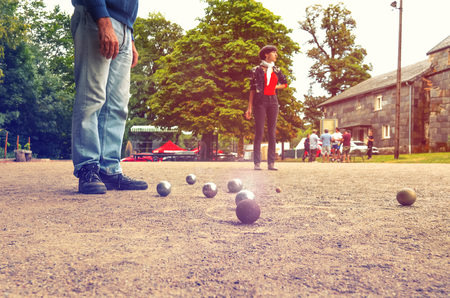 Man and woman playing petanque in th park on holidays Stok Fotoğraf - 109221953