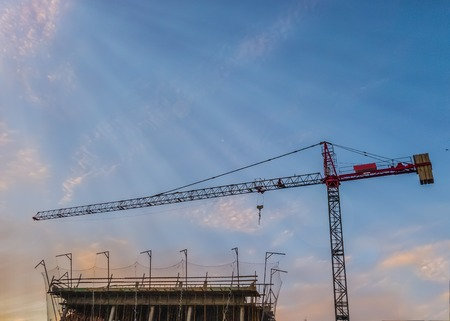 Tower lifting crane over the building construction Stock Photo