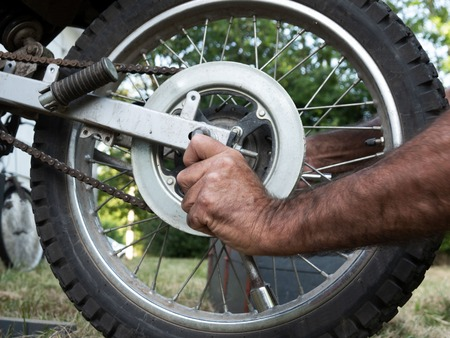 Adjustments on motorbike. Repairs a motorcycle engine. Maintenance