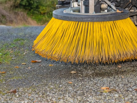 Brushes of cleaning street machine in the road. Stock Photo