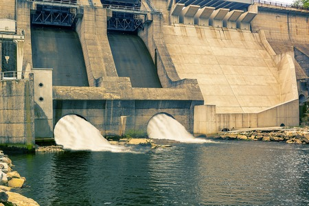 Dam and turbines of a hydroelectric power station with falling water flows