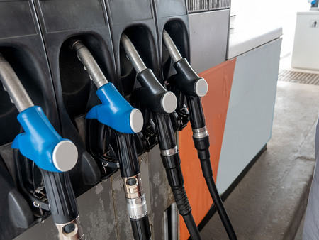 Pump filling nozzles in gas station in a service