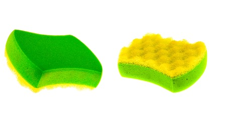 New unused green yellow sponge isolated on white background. The concept of hygiene and cleanliness. Stock Photo