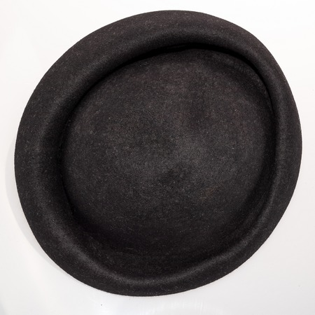 Black felt women's hat vintage fashion early twentieth century isolated on white background . Top view.