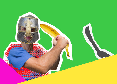 Comic knight with a banana instead of a sword is protected from a fictional enemy. Masculine joke.