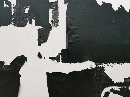 White background with old peeling black paint