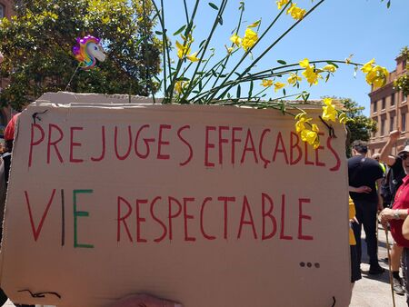 June 08, 2019, Toulouse, France. Homemade cardboard poster in support of freedom in personal life. Inscription in french Erasable prejudices - respectable life.