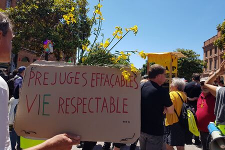 June 08, 2019, Toulouse, France. Yellow vests support Pride March . Inscription in french Erasable prejudices - respectable life.