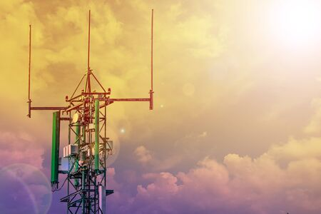 communication tower or 4G 5G network telephone cellsite with cloudyn sky on sunset with copy space