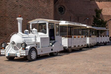 July 29, 2019, Albi, France: small white electric tourist city train waiting for passengers