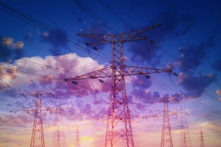 High voltage electrical wire towers against a dramatic sky. Double exposure effect.