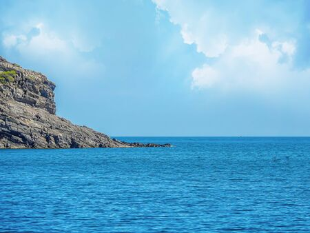 The rock stands in the sea. Travel concept. Seascape.