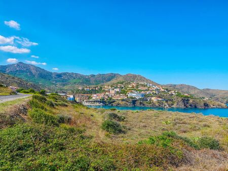 View from the coast to the seaside town Cerbere in a calm bay south of France