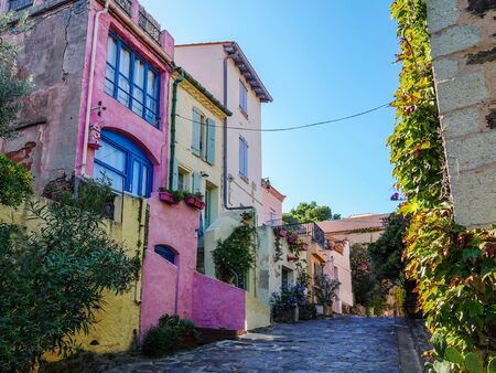 Colorful houses on the narrow streets of a medieval town Collioure in southern France