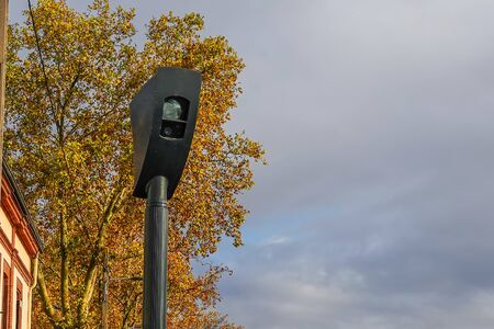Radar for detecting traffic violations for to photograph cars crossing an intersection at a red traffic light .