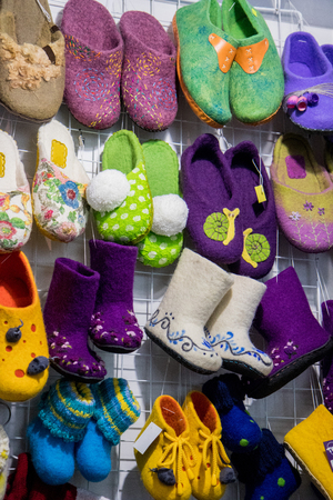 Valenki- Traditional russian colorful felt boots on trade counter