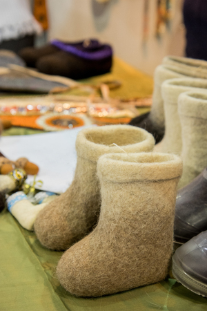 Valenki- Traditional small kids russian gray felt boots on trade counter