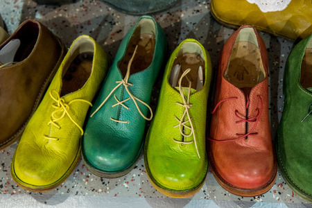 colorful handmade shoes standing in a row