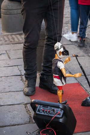 Traditional Neapolitan puppet Pulcinella on the street of Naples, Italy. performance with a puppeteer Stock Photo