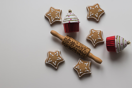 Top view of  Wood Engraved Embossing Rolling Pin with Christmas Symbols for Homemade Christmas Cookies, Baking Christmas cookies and cupcake