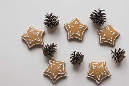 Top view of Baking Homemade Christmas Cookies and pine cones for decoration Stock Photo